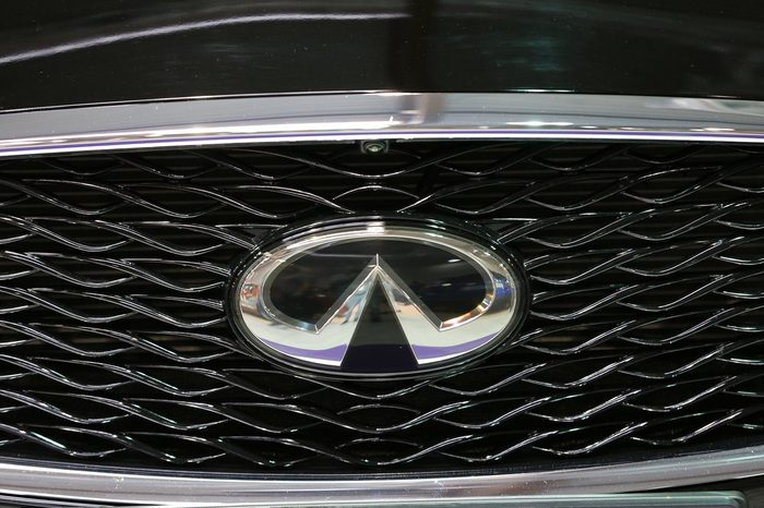 CRACOW, POLAND - MAY 21, 2016: Infiniti metallic logo closeup on the Infiniti car displayed at 3rd edition of MOTO SHOW in Cracow Poland.
