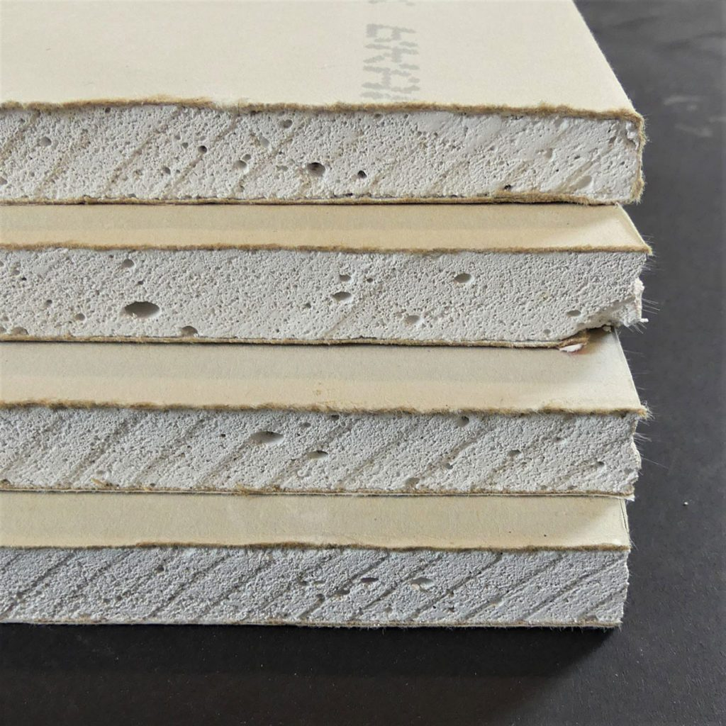Side profile of sheets of drywall showing their thickness