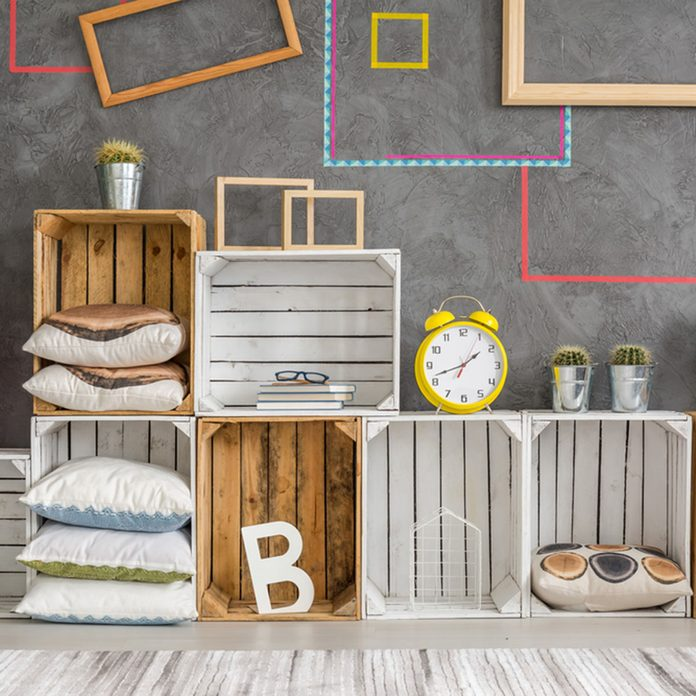 Creative cabinet made of wooden recycled boxes; Shutterstock ID 589573676