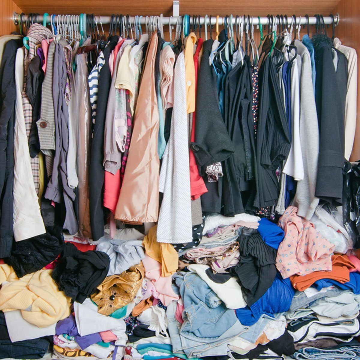 Pile of messy clothes in closet. Untidy cluttered woman wardrobe.; Shutterstock ID 601072265; Job (TFH, TOH, RD, BNB, CWM, CM): Taste of Home