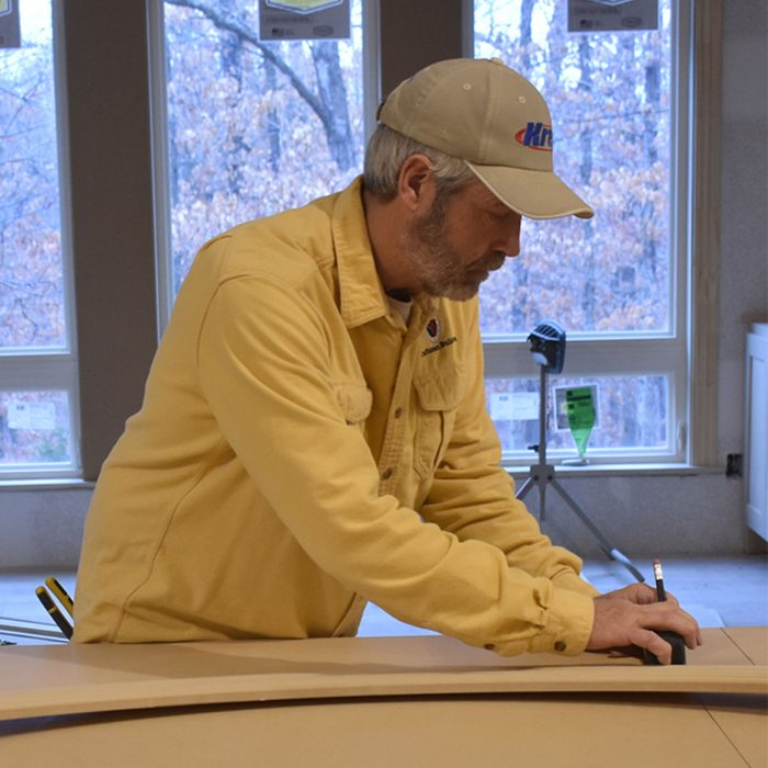 Marking where the radius trim will hit the casing | Construction Pro Tips