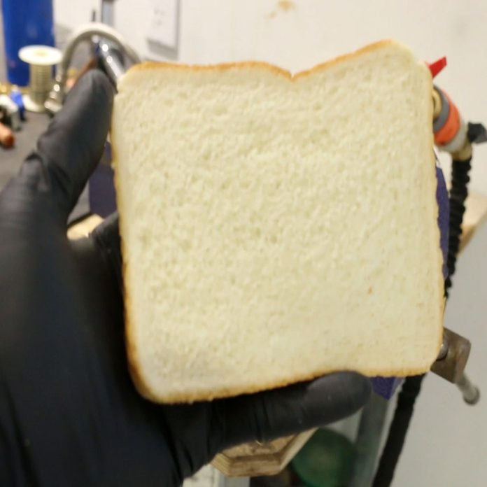 Some bread in a hand | Construction Pro Tips