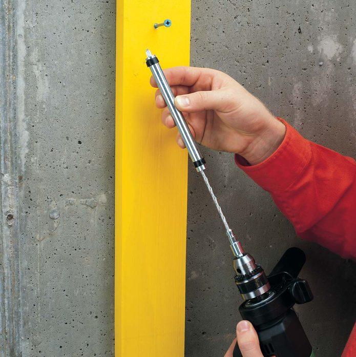 pilot drill bit and a screwdriver sleeve