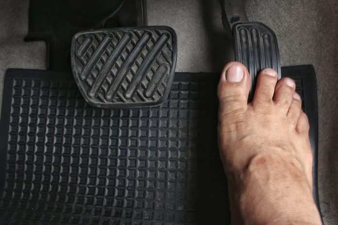 Close up driver's bare foot on pedal in car ,Safety to driving concept.