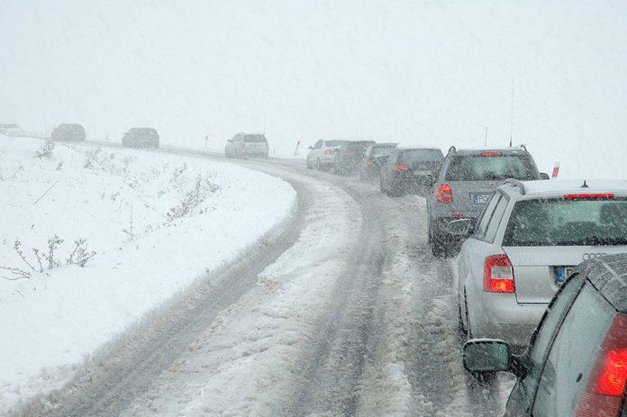 JELENIA GORA, POLAND - MAY 03: Traffic jam on mountain road caused by heavy snowfall on May 3, 2011 nearby Jelenia Gora Poland