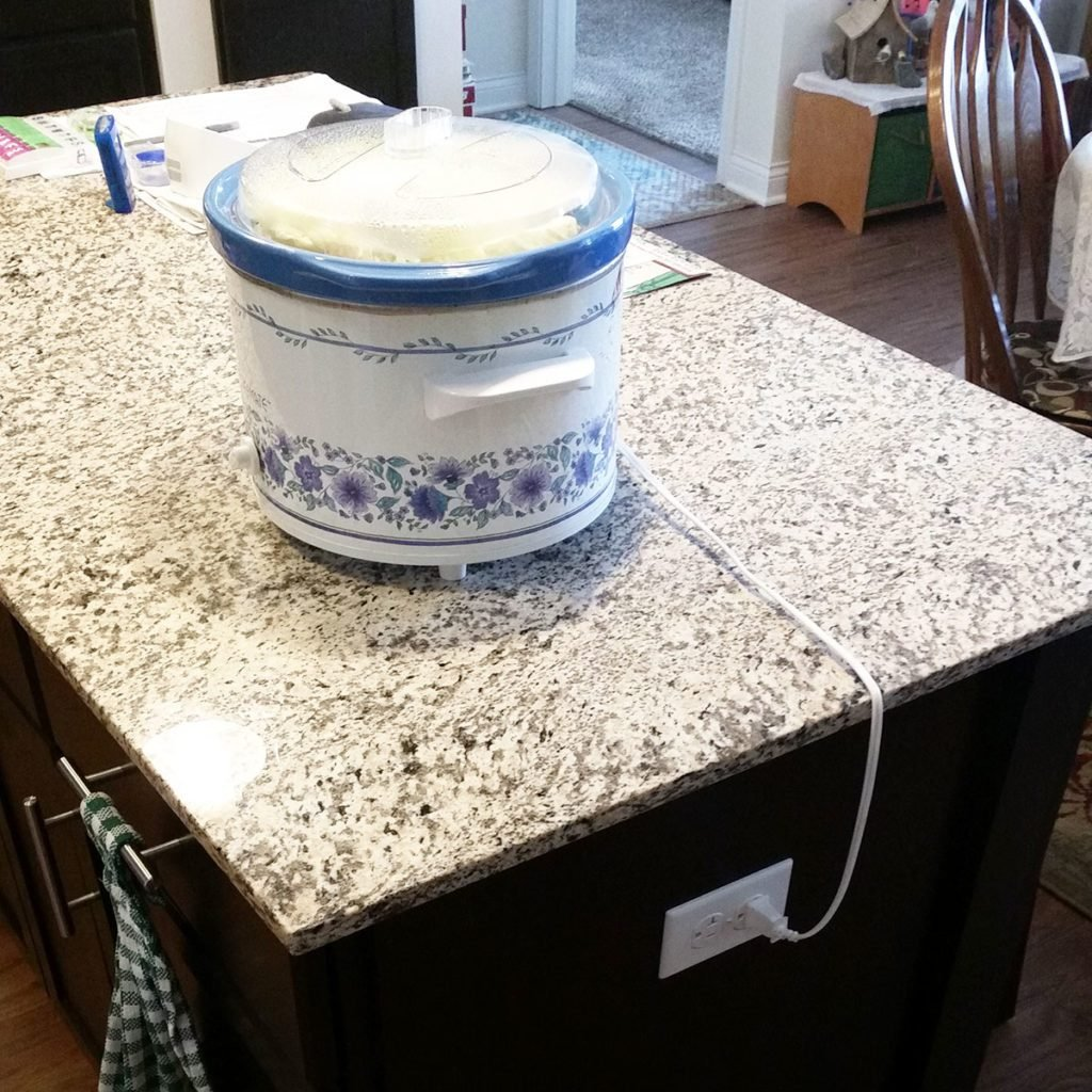 Crock pot plugged into an island electrical outlet | Construction Pro Tips