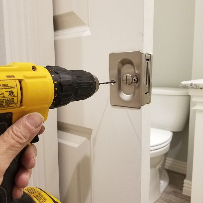 Drilling the hardware into place   Construction Pro Tips