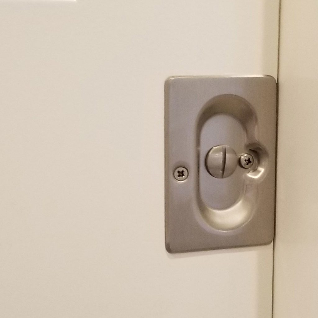 A close-up look at pocket door privacy hardware | Construction Pro Tips