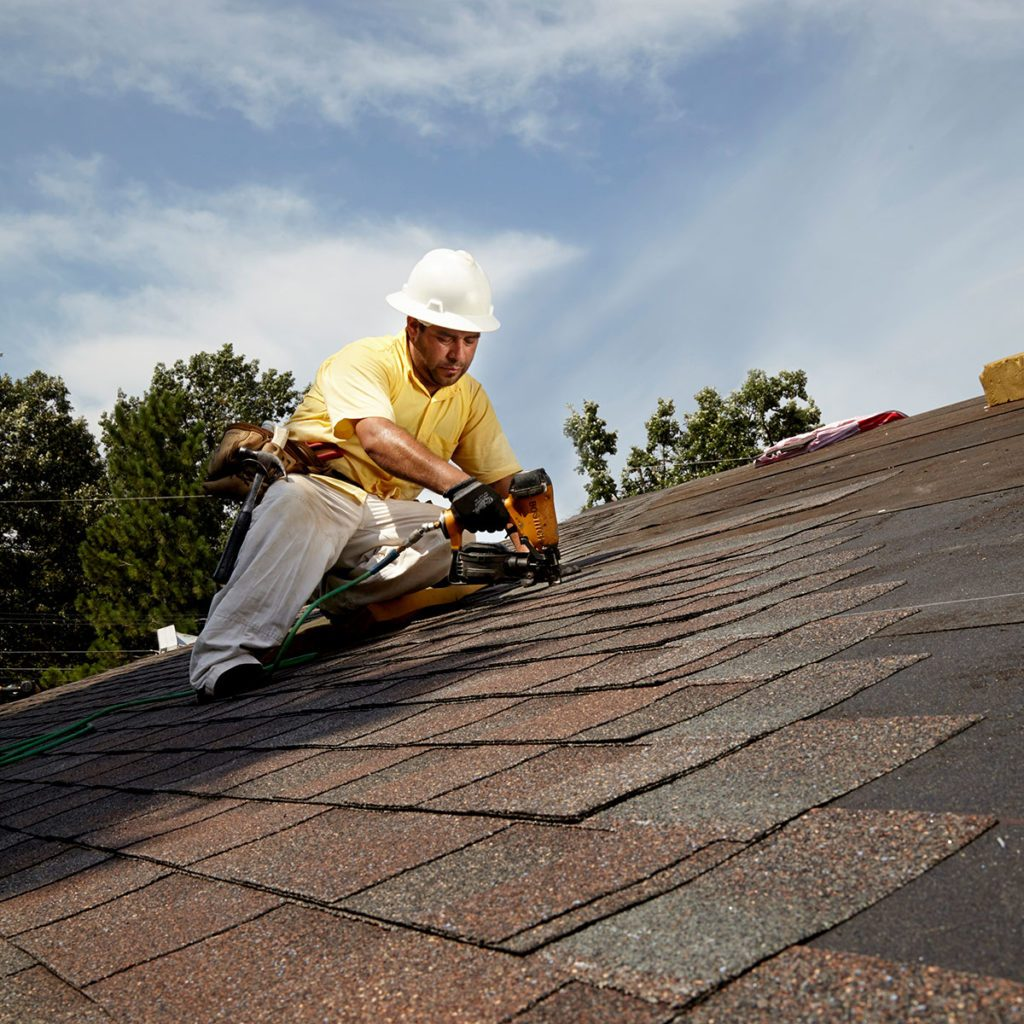 A man roofing a house | Construction Pro Tips