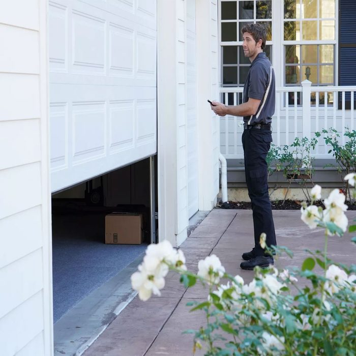 Delivery man closing garage after delivering a package | Construction Pro Tips