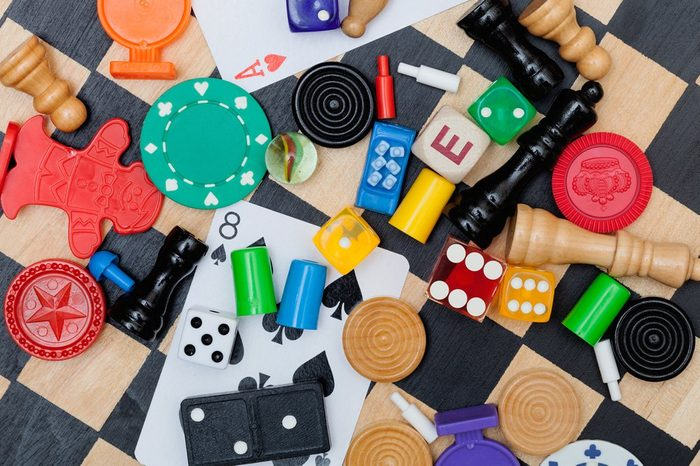 Miscellaneous board game pieces on a chess board