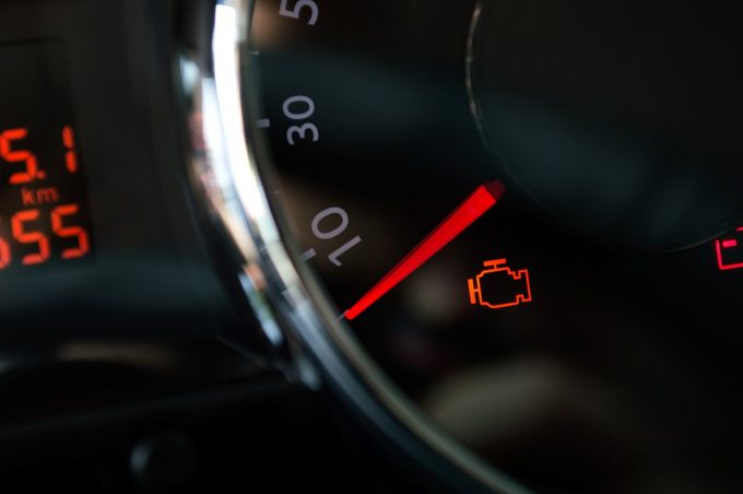 Check engine light. Car dashboard in closeup