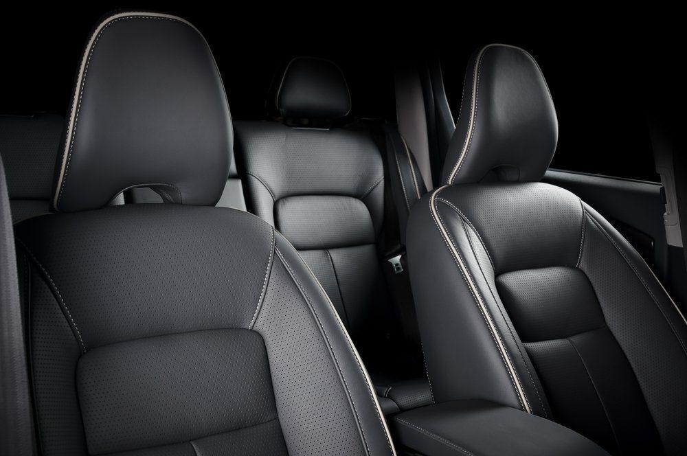 Luxury car inside. Interior of prestige modern car. Comfortable leather seats. Black perforarated leather cockpit.