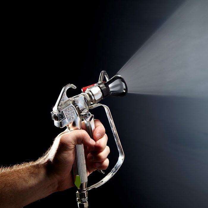 spraying paint out of an exterior spray painter | Construction Pro Tips