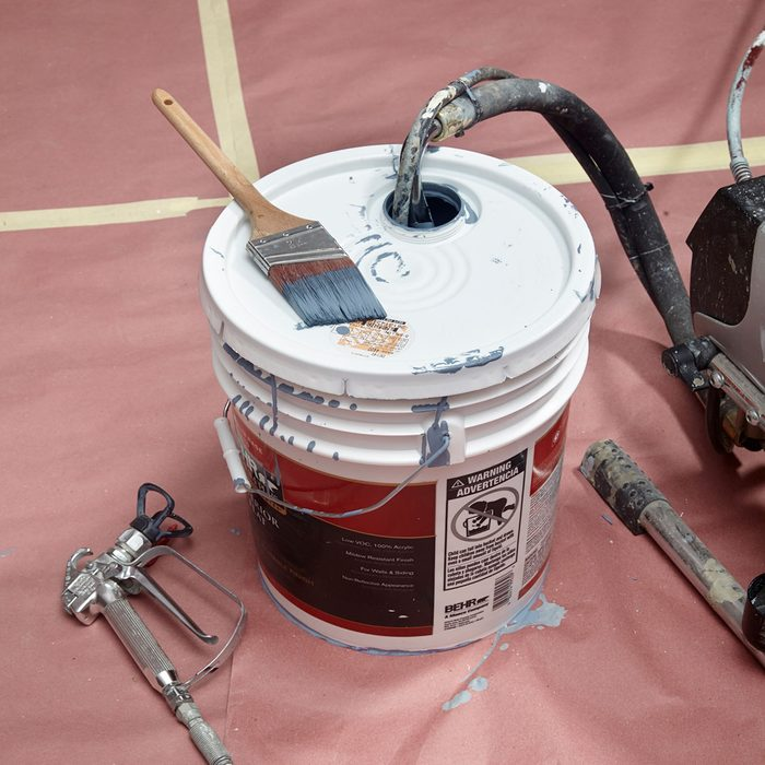getting paint from a bucket into a spray painter | Construction Pro Tips