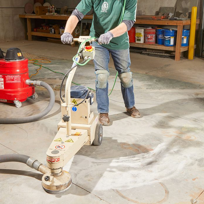 Operating a grinder on an uneven concrete slab | Construction Pro Tips
