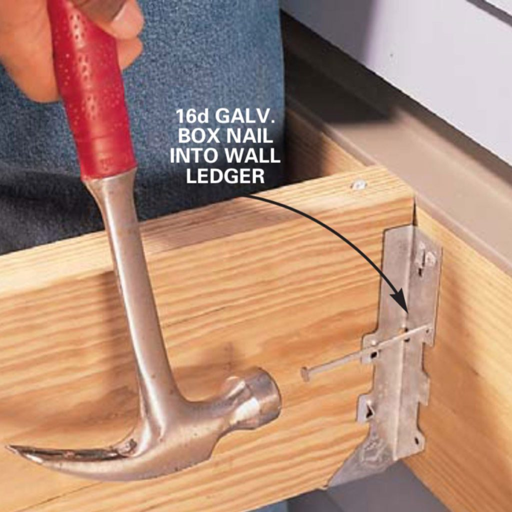 Nailing down the hanger into the ledger   Construction Pro Tips