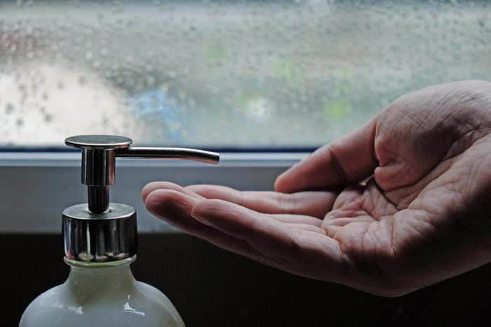 men hand waiting for lotion in raining day, men skin care concept