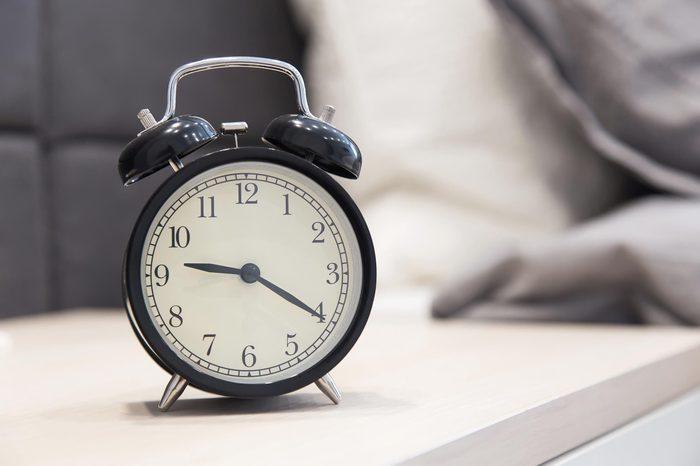 alarm clock on the nightstand beside the bed. Interior bedroom