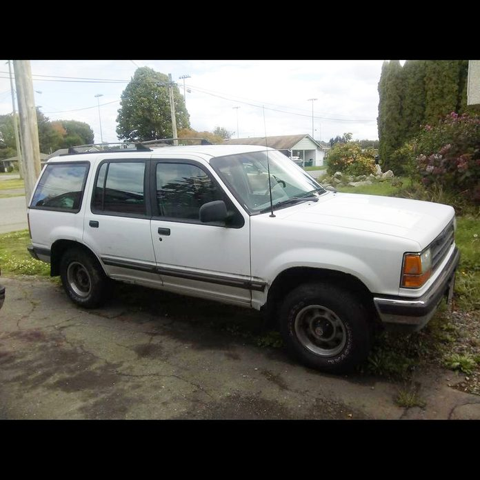 A 1991 white Ford Explorer sits in a driveway