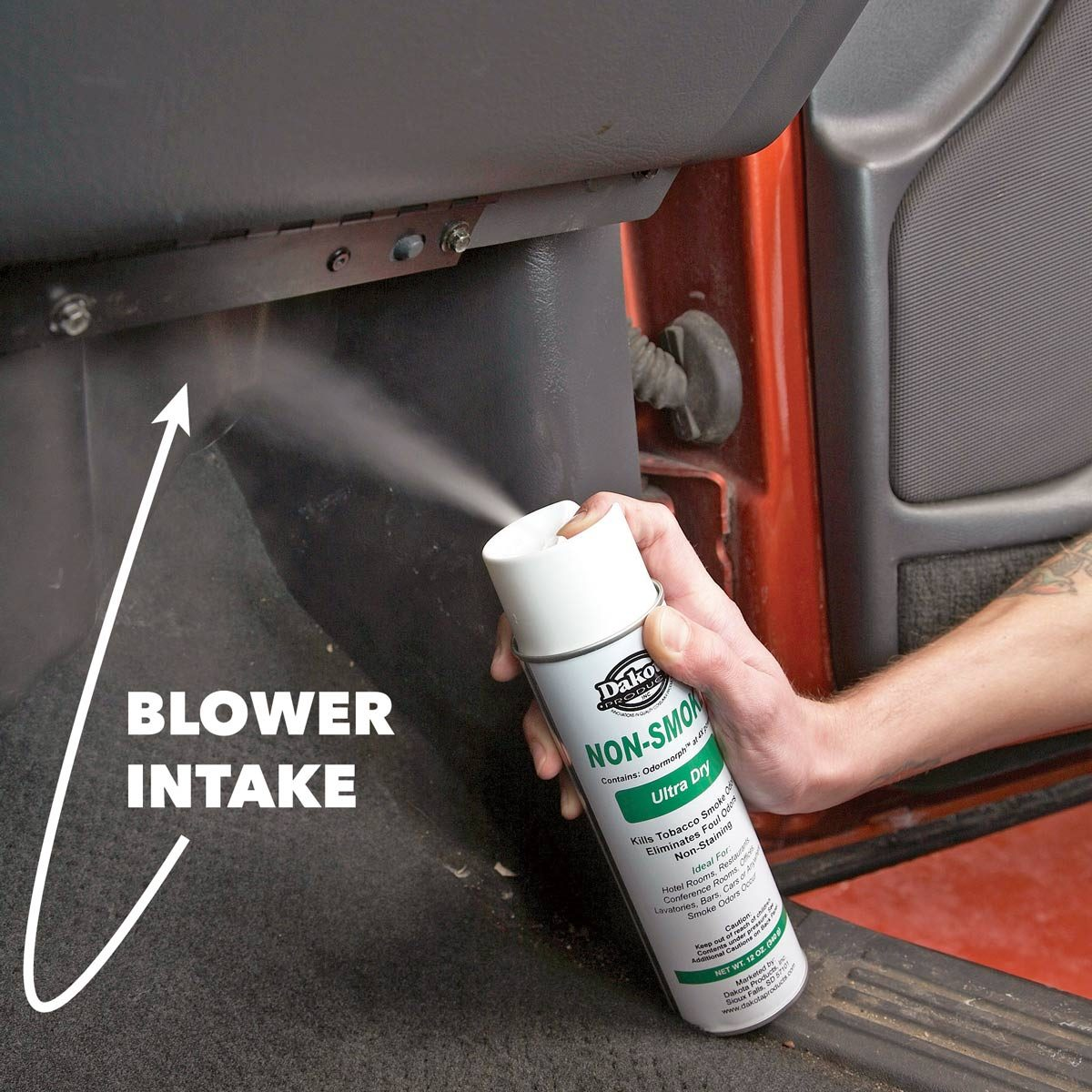 aerosol can sprays smell remover into car blower intake