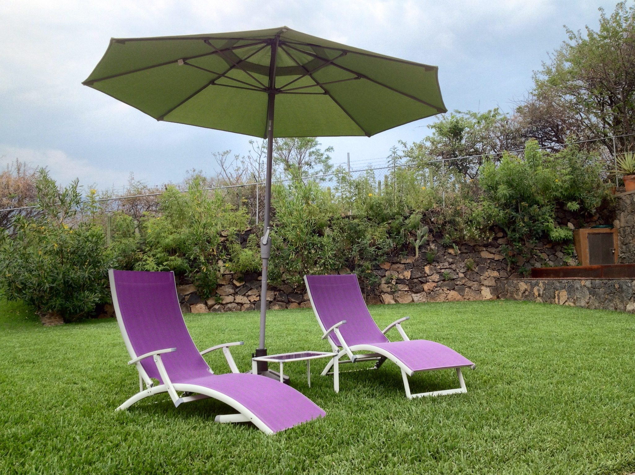 Patio Umbrella With Lounge Chair In Field