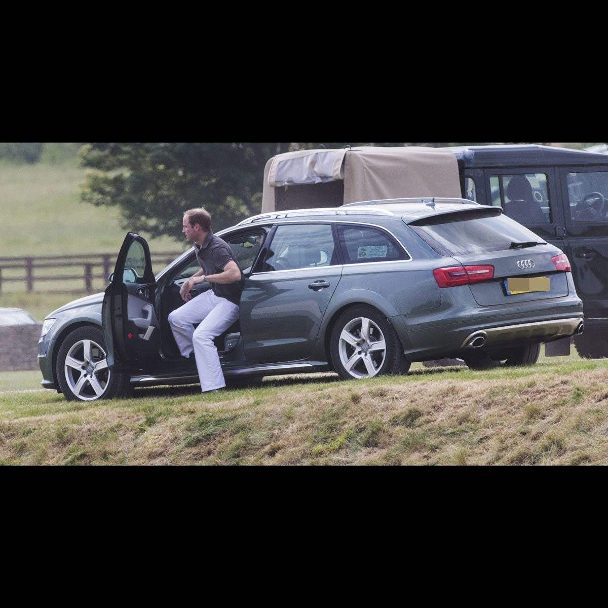 Prince William gets out of Prince Charles' Audi wagon in the country
