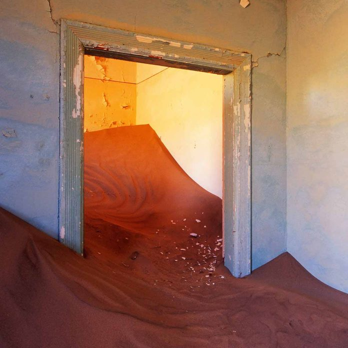 Abandoned-Home-filled-with-sand