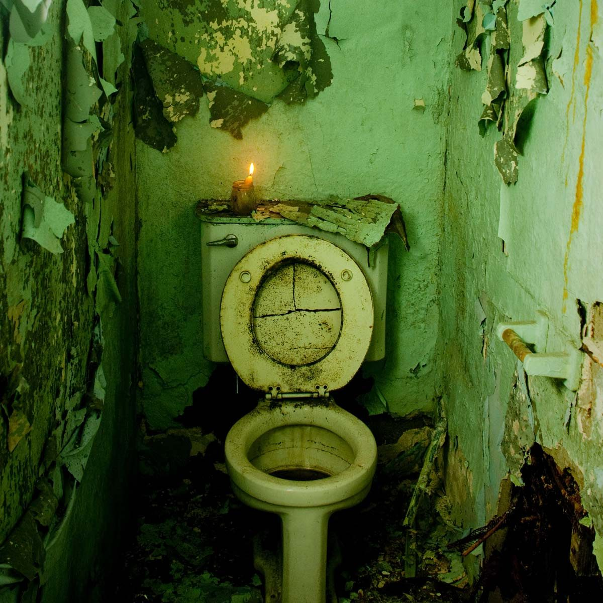 Abandoned-bathroom-with-a-candle-lit