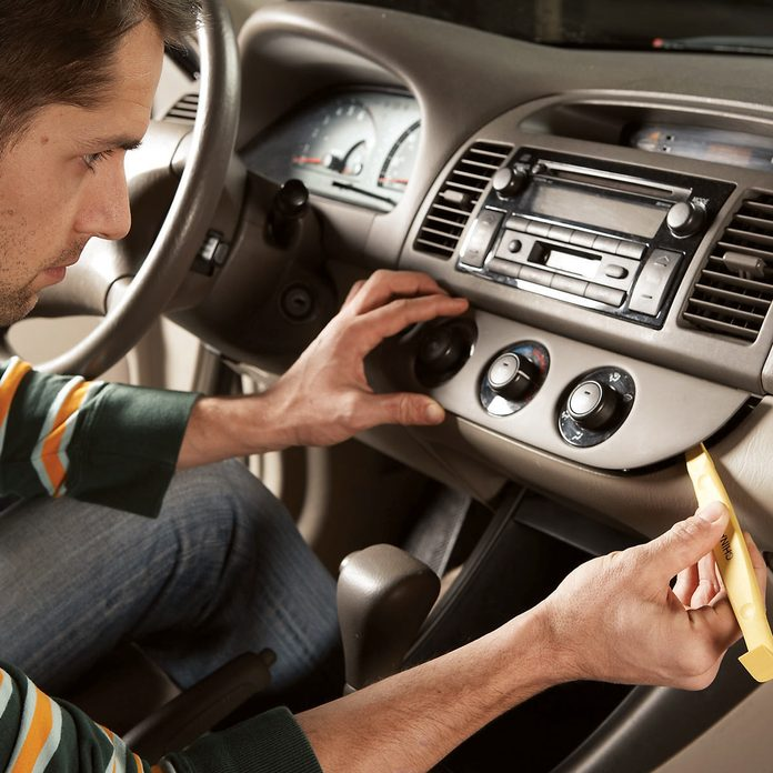 Man pulls away car dashboard panel