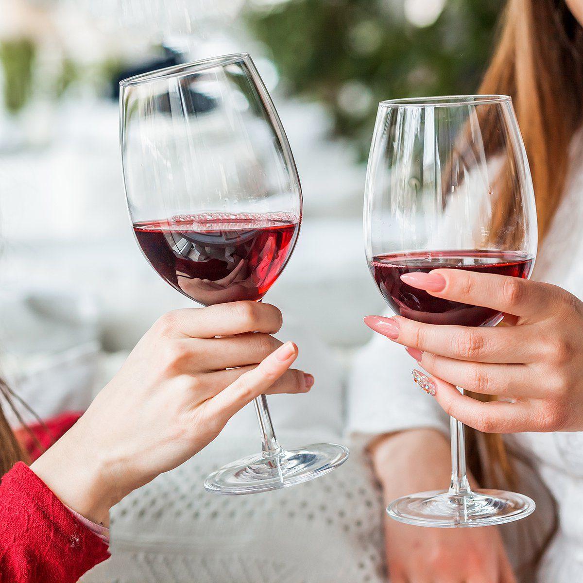 Two female friends drinking wine in restauran