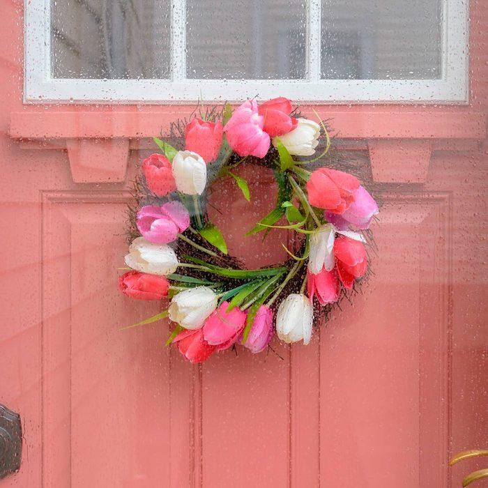 pink front door with tulip wreath