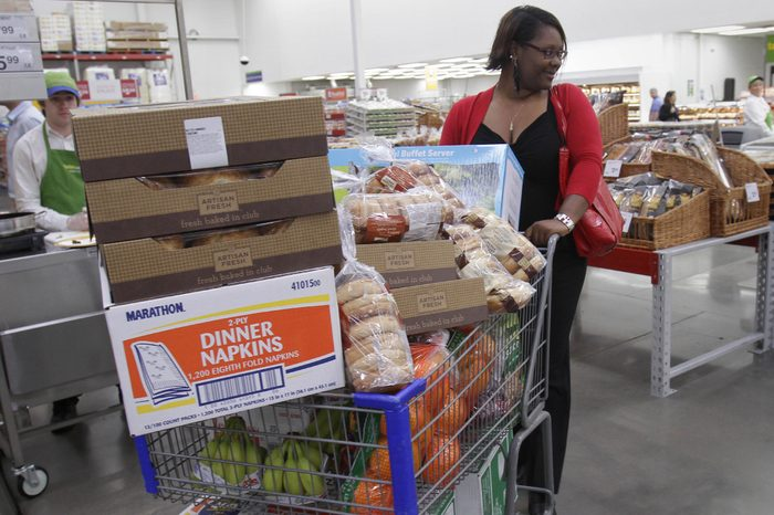 Shopper Leslie Corridon pushes a cart at a Sam's Club store in Rogers, Ark