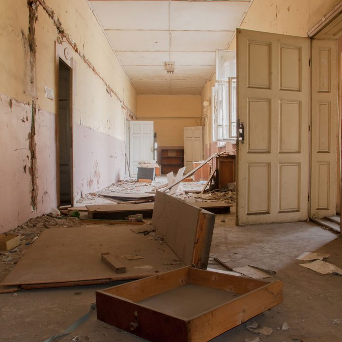 Abandoned-corridor-and-destroyed-desks-and-lockers-in-an-old-school-building-Sofia-Bulgaria