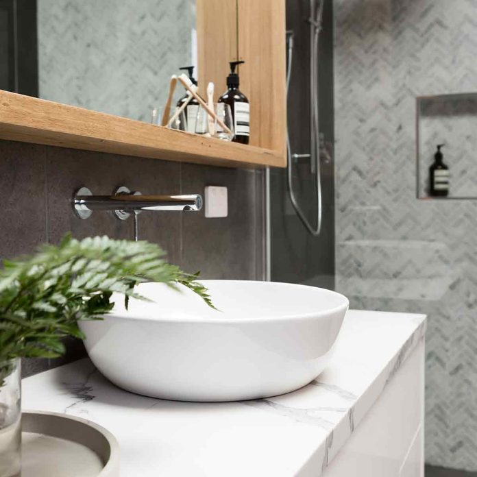 Charcoal-Bathroom-details-clean-white-basin-with-shower-tiling-behind