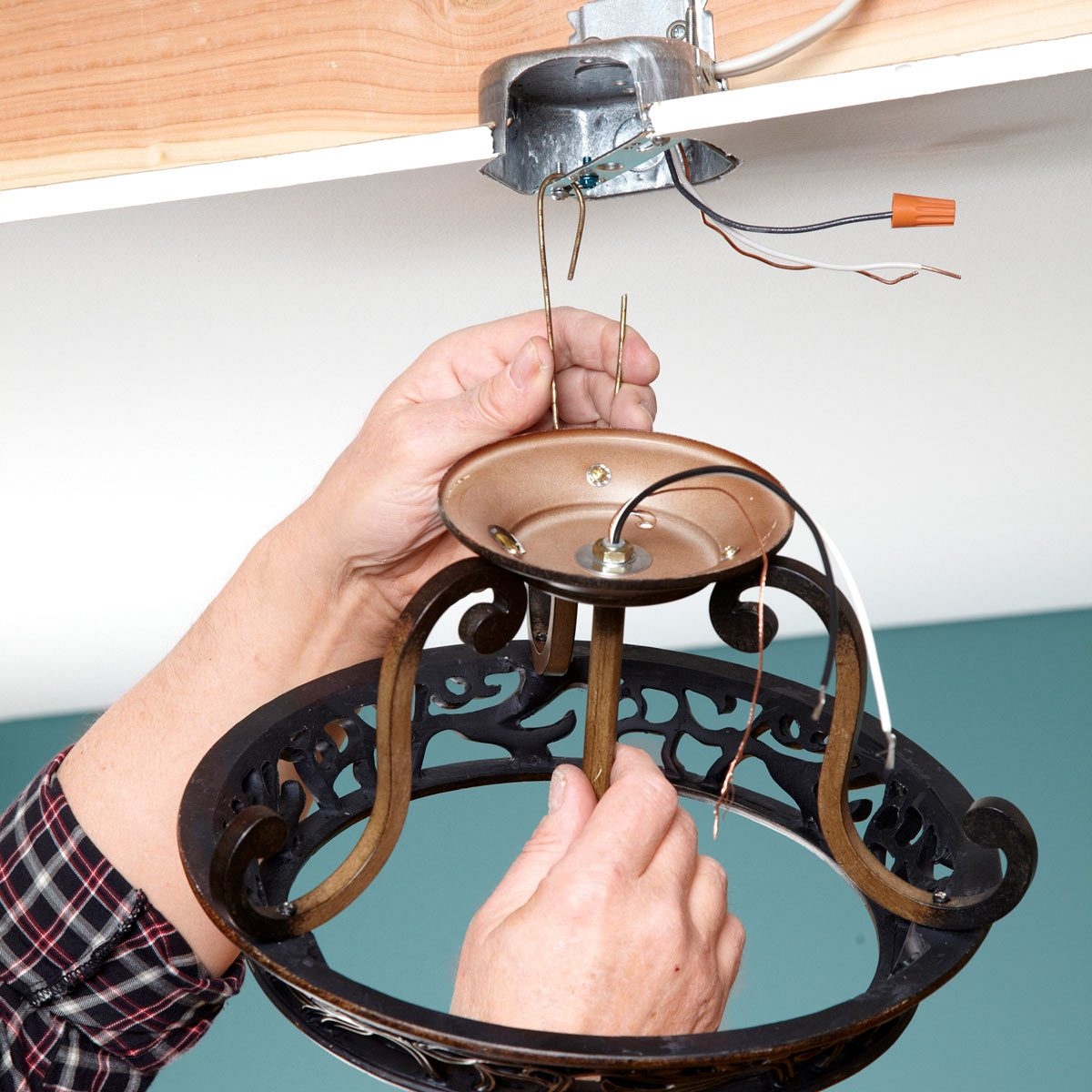 third hand installing light fixture