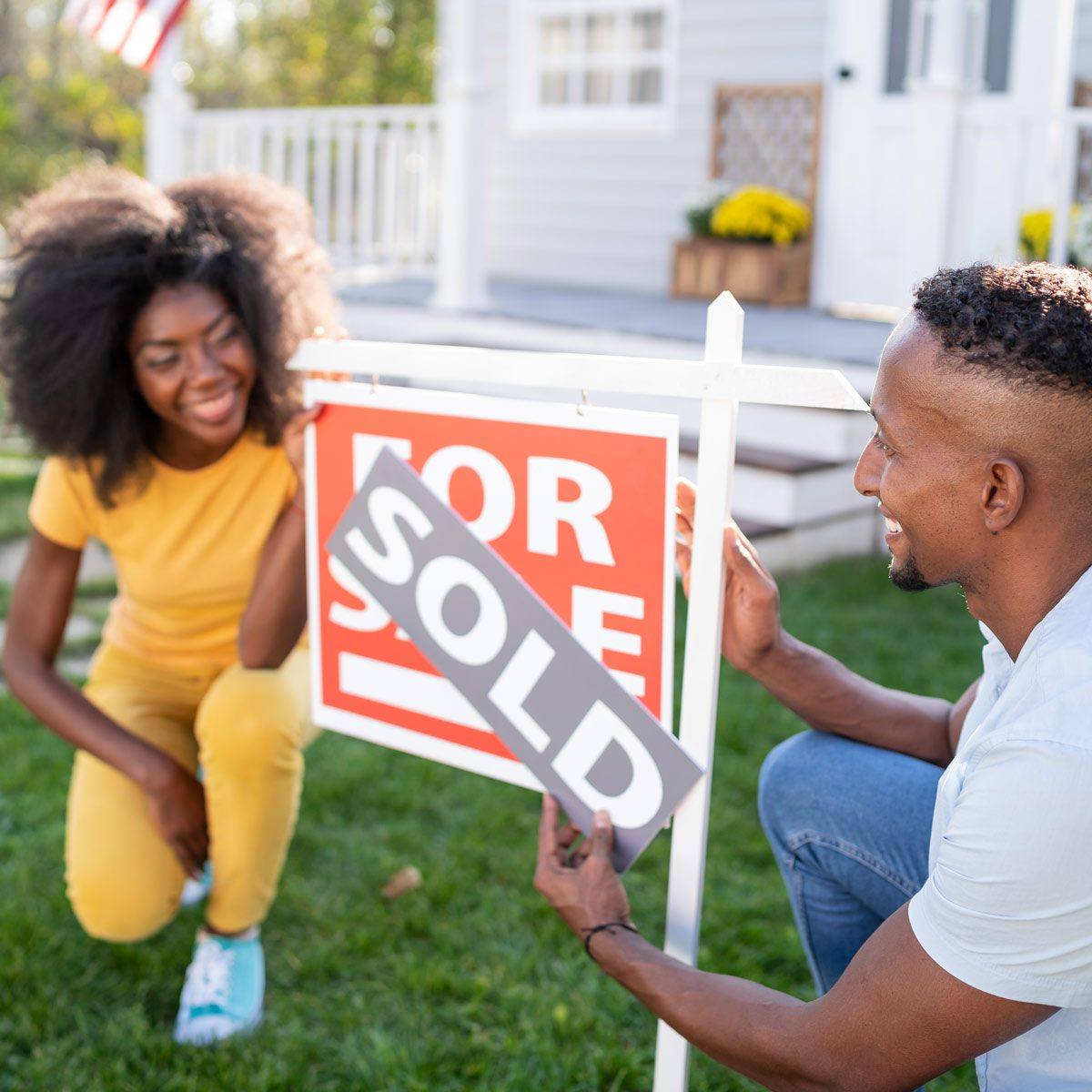 Young couple buying a new house home for sale home sold