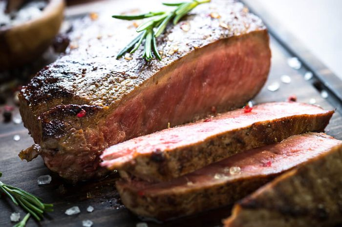 Fresh grilled meat. Grilled beef steak medium rare on cutting board. Close up.