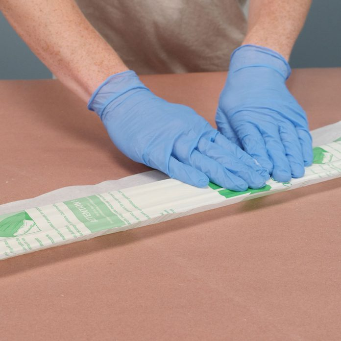 remove paint from wood laminated paper