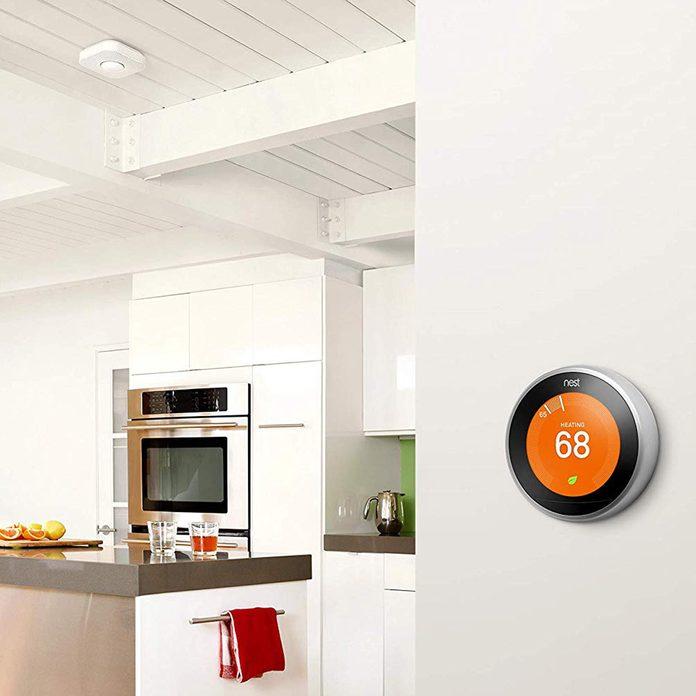 Nest smart thermostat in kitchen