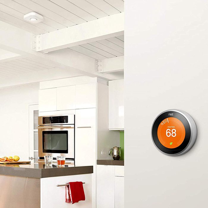 Nest smart thermostat in kitchen