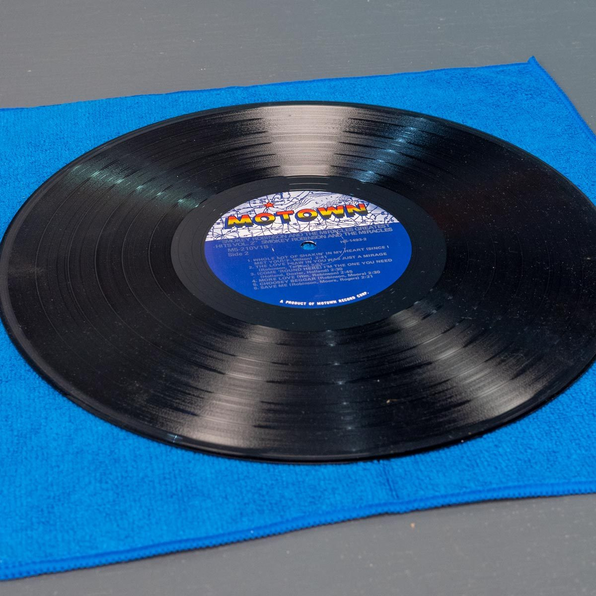 clean record on microfiber cloth