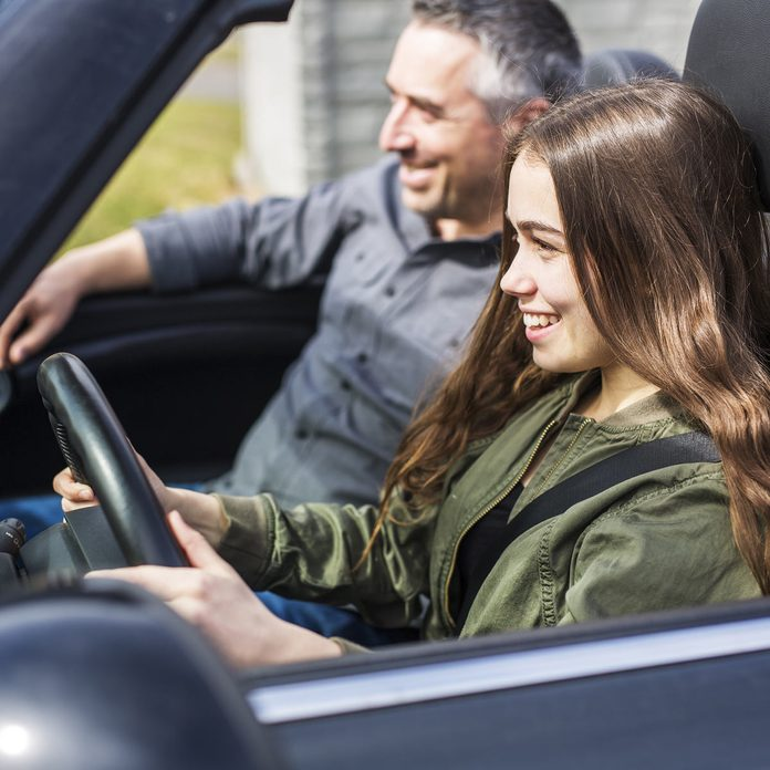 Teenage-girl-drives-car-with-father-in-passenger-seat