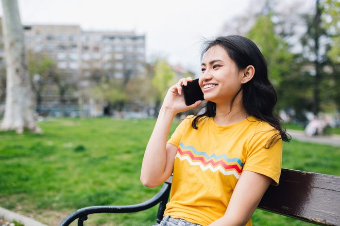 Young Asian Woman talking on her phone