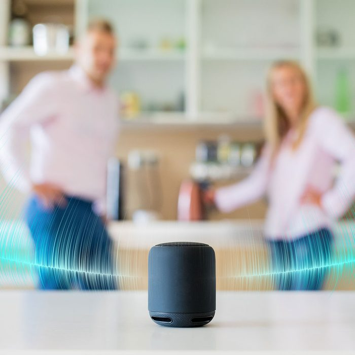 two people listening to music on a smart speaker