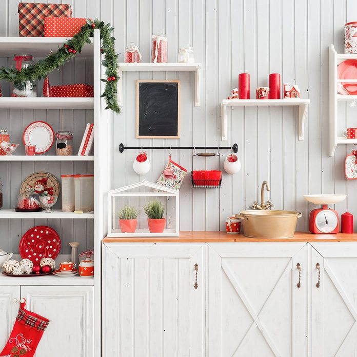 Interior light grey kitchen and red christmas decor