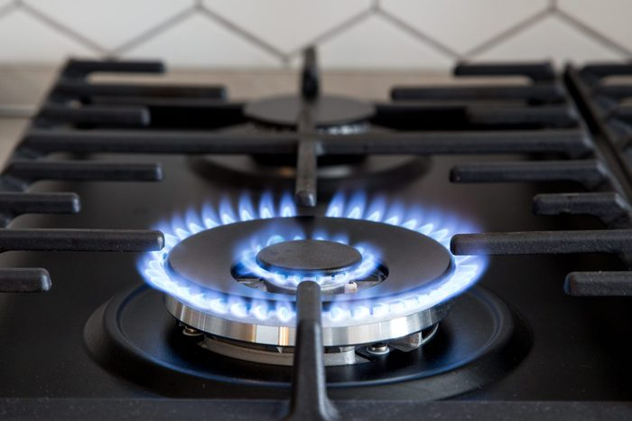 Gas burner on black modern kitchen stove. kitchen gas cooker with burning fire propane gas