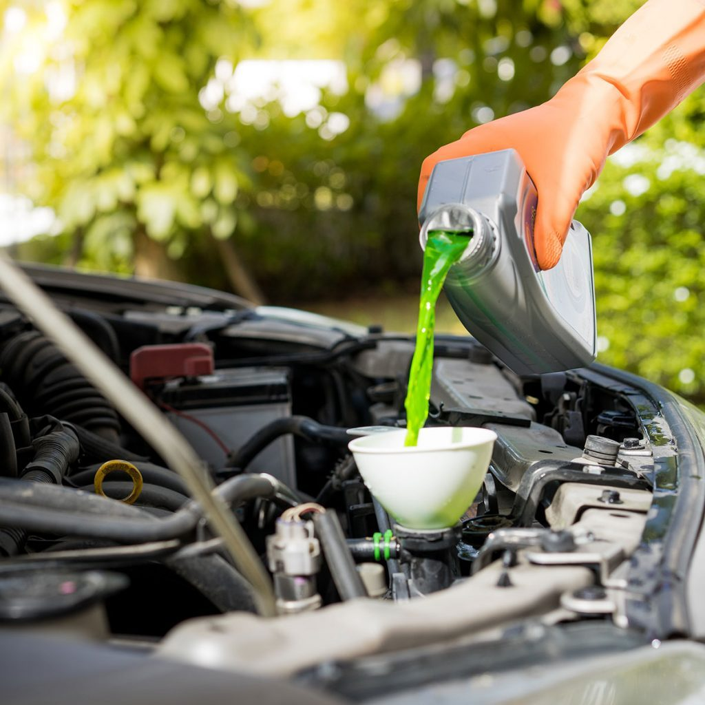 green antifreeze poured into coolant system