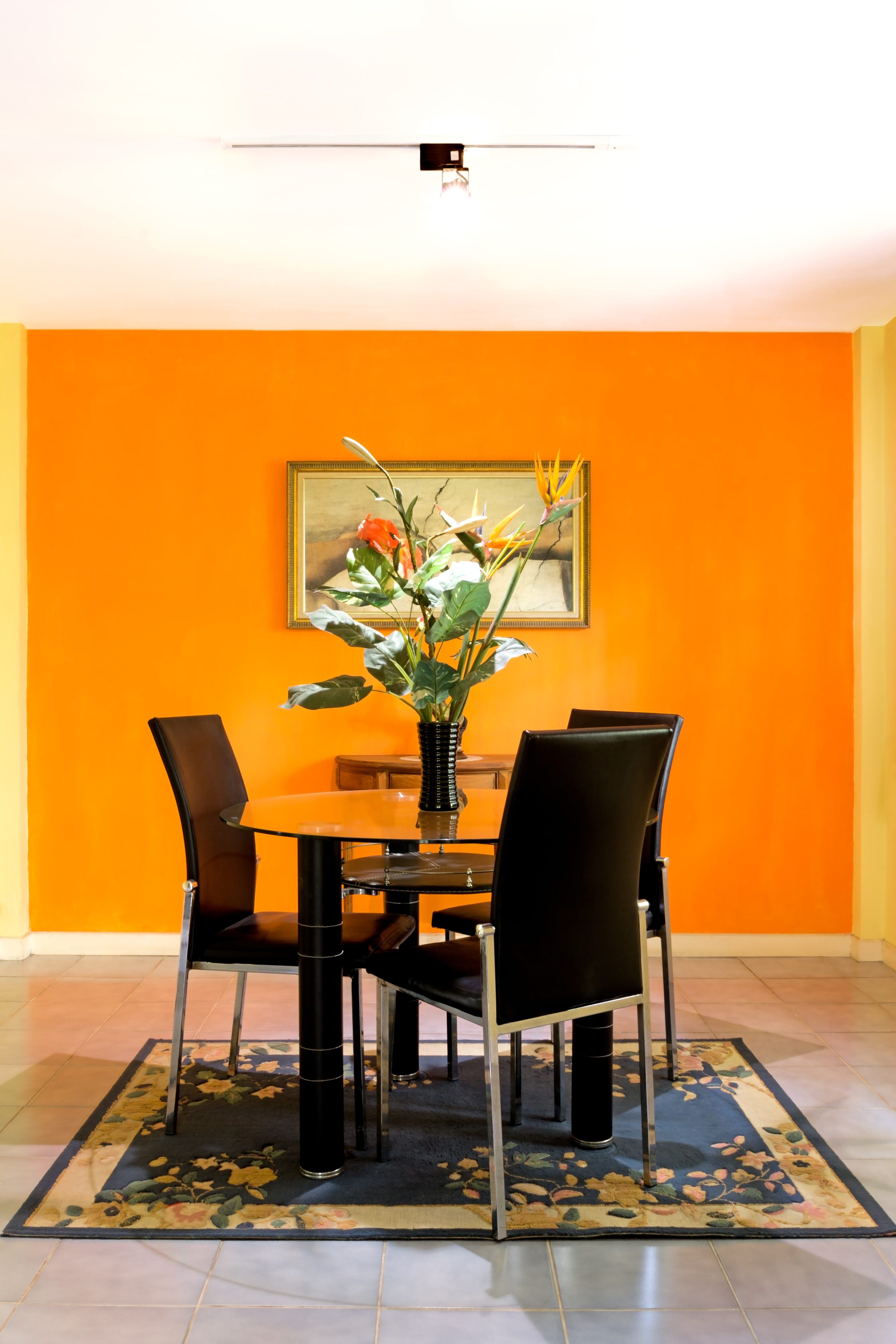 dining room on orange wall background