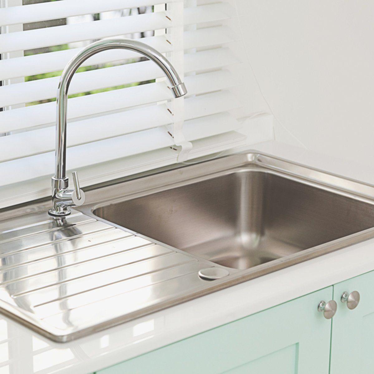 Modern kitchen sink, green tone; Shutterstock ID 507453130
